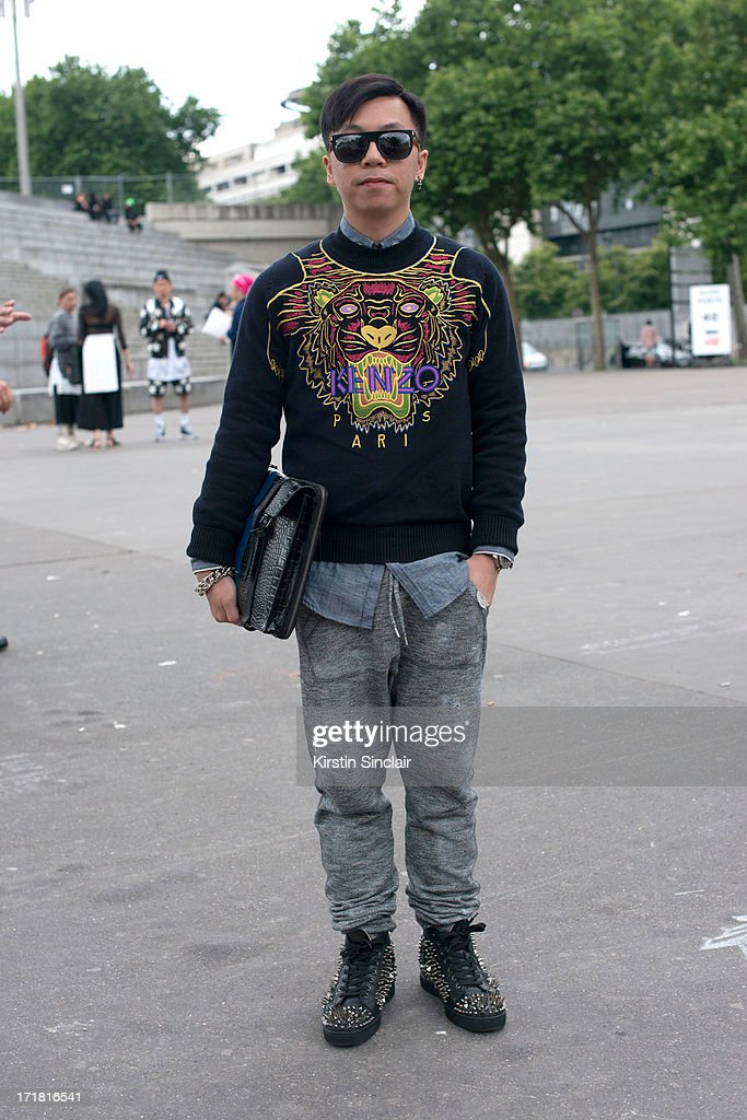 Fashion Buyer Edison Kang wears Christian Louboutin trainers, Dsquared trousers and shirt, Kenzo sweater, Super sunglasses and a Dries Van Notebn bag on day 3 of Paris Collections: Men on June 28, 2013 in Paris, France.