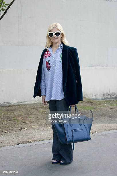 Fashion Buyer Eva Galambos wears a Balmain jacket Celine bag top and trousers Dior sunglasses and Balenciaga shoes on day 6 during Paris Fashion Week...