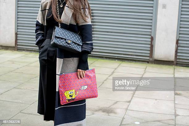 Fashion buyer for Liberty Sophie Pate wearing an Acne coat sweater and culottes Chanel bag Liberty clutch bag on day 1 of London Collections Men on...