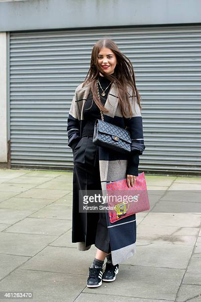 Fashion buyer for Liberty Sophie Pate wearing an Acne coat sweater and culottes Chanel bag Liberty clutch bag and Adidas trainers on day 1 of London...