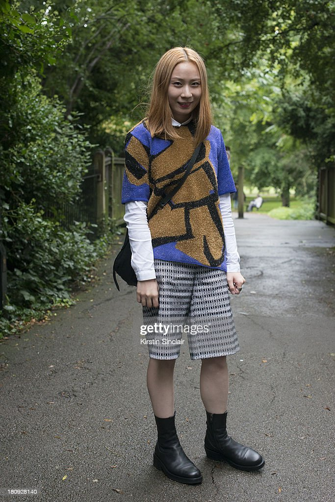 Fashion buyer for LN-CC Yue Huang wears Ann Demeulemeester shoes, Emiliano Rinaldi shorts, Lucas Nascimento sweater and a Proenza Schouler bag on day 5 of London Fashion Week Spring/Summer 2013, at Somerset House on September 17, 2013 in London, England.