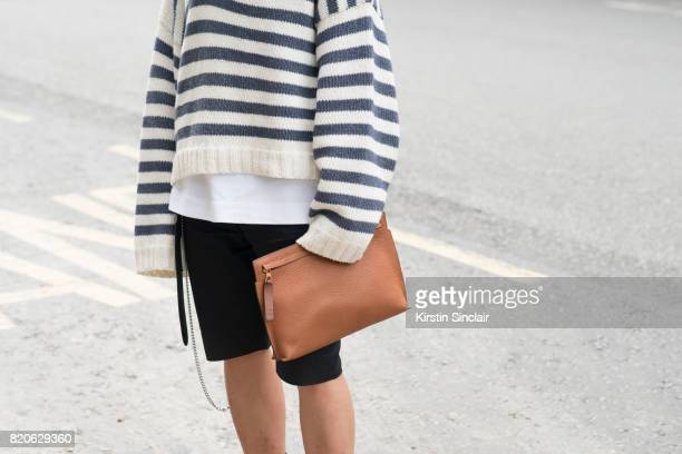 Fashion buyer Jonathan Lee wears a Loewe bag Balenciaga shorts Charles Jeffrey Loverboy jumper on day 3 of London Collections Men on June 12 2017 in...