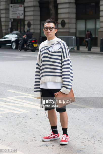 Fashion buyer Jonathan Lee wears a Loewe bag Vans trainers Balenciaga shorts Alyx T shirt Charles Jeffrey Loverboy jumper Fila socks on day 3 of...