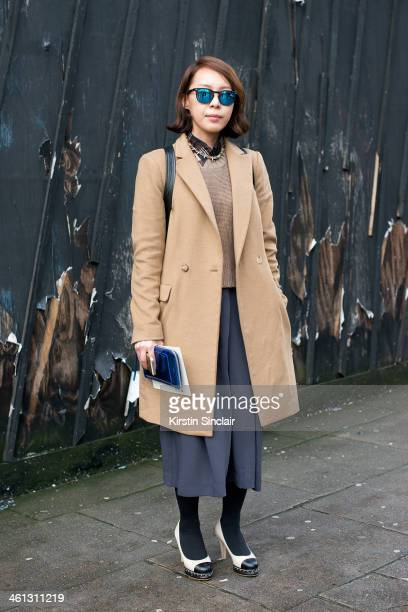 Fashion Buyer Kay Kim wears Chanel shoes H and M culottes and sweater Dries Van Noten shirt Spec Trek sunglasses Tom Boy bag and a Steven Alan jacket...