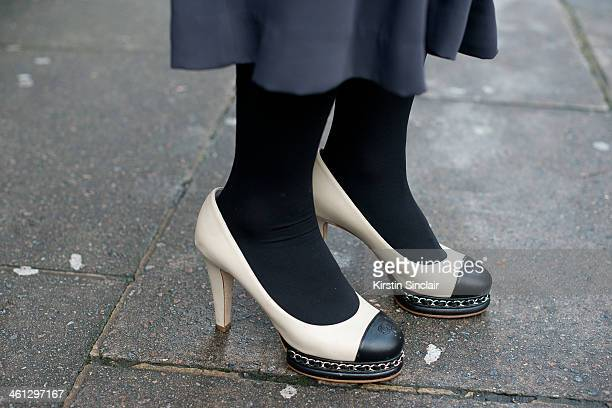 Fashion Buyer Kay Kim wears Chanel shoes H and M culottes on day 1 of London Mens Fashion Week Autumn/Winter 2014 on January 06 2014 in London England