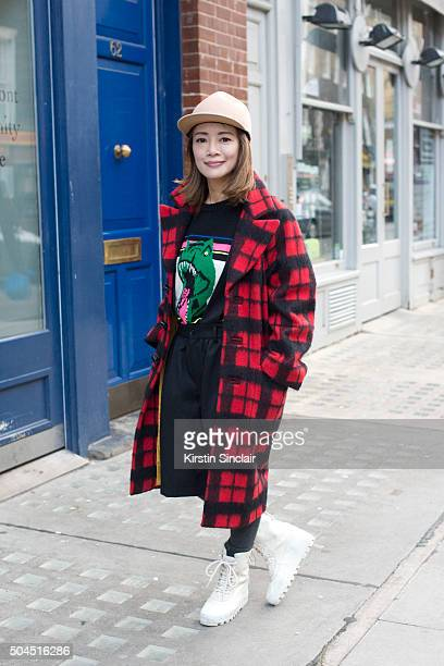 Fashion buyer Kiwi Mai wears a Dsquared2 coat Saint Laurent jumper Comme Des Garcons culottes and Yeezy 950 boots on day 3 of London Collections Men...