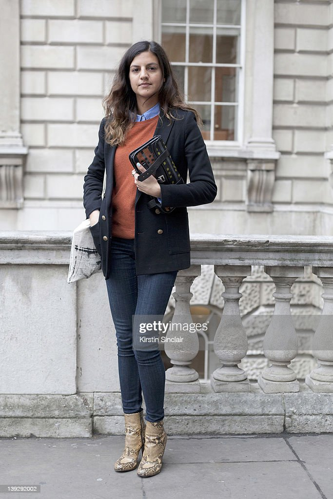 Fashion buyer Lisa Jones wearing Dries van noten boots Cos jeans and sweater Gap shirt Rag and Bone jacket and Proenza Schouler clutch at London...
