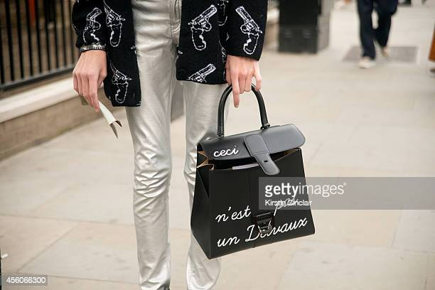 Fashion Buyer Pascaline Smets is wearing a Delvaux bag Saint Laurent knit and trousers on day 5 of London Collections Women on September 16 2014 in...