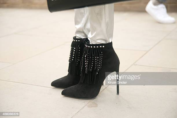 Fashion Buyer Pascaline Smets is wearing a Delvaux bag Saint Laurent trousers on day 5 of London Collections Women on September 16 2014 in London...