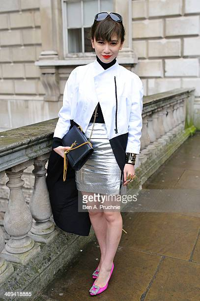 Fashion Buyer poses wearing an outfit by Hijen Wang with Banana Boat shoes and a YSL bag at Somerset House at London Fashion Week AW14 at on February...