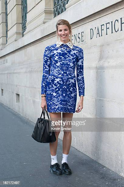 Fashion buyer Veronika Heilbrunner wears a Valentino dress Prada bag and Doc Martins shoes on day 4 of Paris Fashion Week Spring/Summer 2014 Paris...