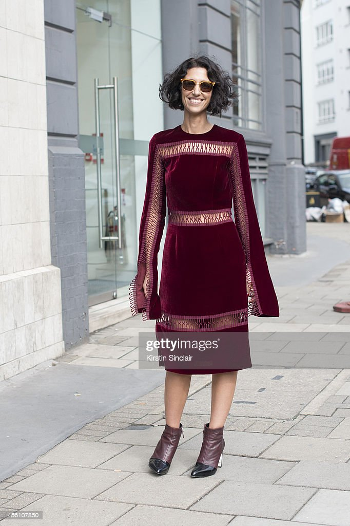 Fashion buyer Yasmin Sewell wears a Christopher Kane dress, Kenzo boots and vintage sun glasses on day 4 of London Fashion Week Spring/Summer 2013, at Somerset House on September 16, 2013 in London, England.