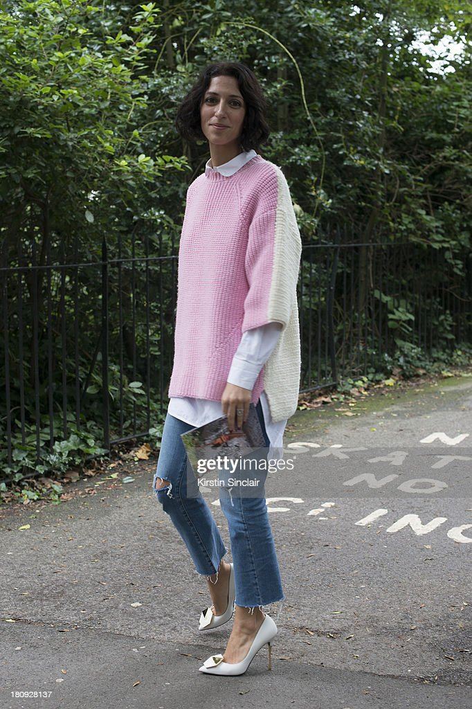 Fashion buyer Yasmin Sewell wears J S Lee jumper, Celine shirt, Top Shop pants and Nicholas Kirkwood shoes on day 5 of London Fashion Week Spring/Summer 2013, at Somerset House on September 17, 2013 in London, England.