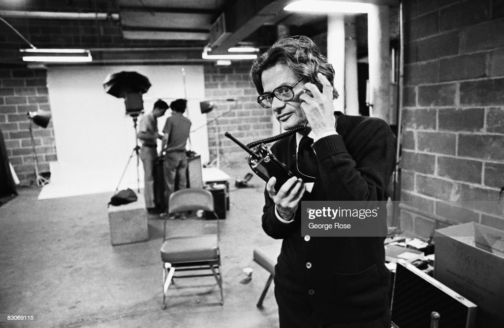 Fashion celebrity and art photographer Richard Avedon talks on a walkietalkie during a 1976 New York New York photo session for Rolling Stone Magazine