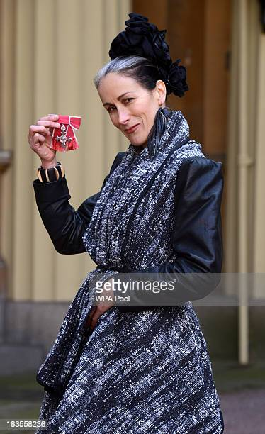 Fashion commentator Caryn Franklin at Buckingham Palace where she received an MBE during an investiture ceremony on March 12 2013 in London England