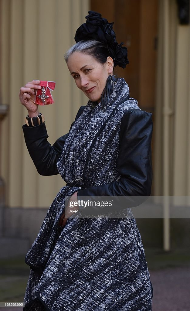 Fashion commentator Caryn Franklin poses for photographs after she received an MBE at Buckingham Palace in London on March 12, 2013. AFP PHOTO/POOL/Stefan Rousseau
