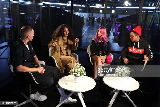 Fashion commentator Fabian Hart German singer Joy Denalane and fashion bloggers Nives Arrigoni and Ilja Jay attend the BB Box Panel talk during the...