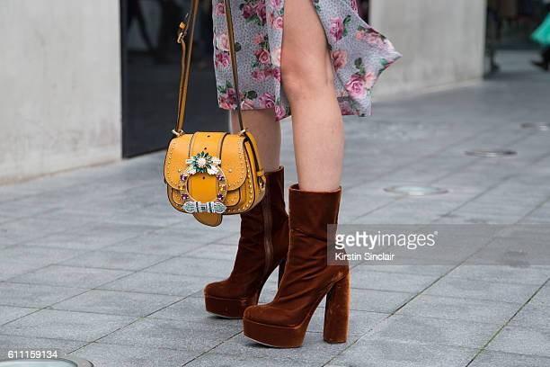 Fashion consultant Blanca Miro wears Tom Ford dress and Miu Miu Shoes and bag on day 3 of London Womens Fashion Week Spring/Summer 2017 on September...