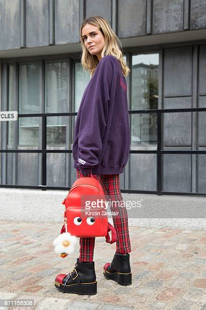 Fashion consultant Blanca Miro wears Vetements top vintage trousers Prada shoes and Anya Hindmarch bag on day 3 of London Womens Fashion Week...