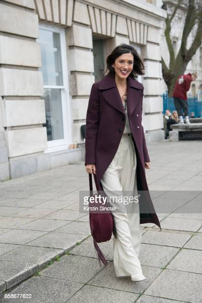 Fashion consultant Hikari Yokoyama wears a Mulberry coat top and trousers and an Altuzarra bag on day 3 of London Womens Fashion Week Autumn/Winter...