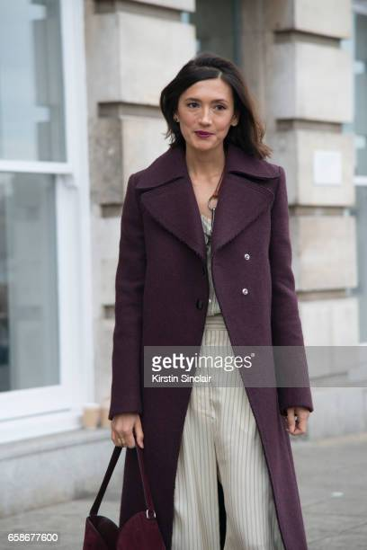 Fashion consultant Hikari Yokoyama wears a Mulberry coat top and trousers on day 3 of London Womens Fashion Week Autumn/Winter 2017 on February 19...