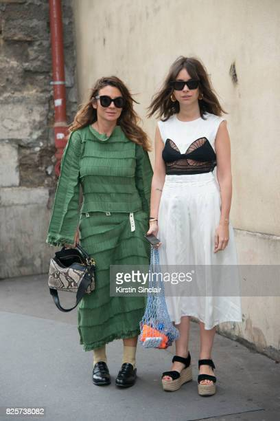 Fashion consultant Natasha Goldenberg wearing a Loewe dress with Lisa Molchanova wearing a Loewe dress and bag a day 1 of Paris Haute Couture Fashion...