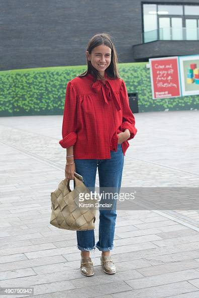 Fashion Consultant Natasha Goldenberg wears a JW Anderson top Loewe bag and Stella McCartney shoes on day 3 during London Fashion Week Spring/Summer...