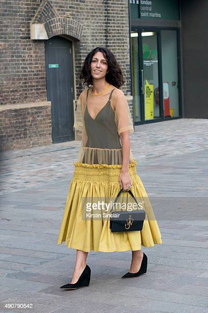 Fashion Consultant Yasmin Sewell wears a Molly Goddard dress JW Anderson bag and Nicholas Kirkwood shoes on day 3 during London Fashion Week...