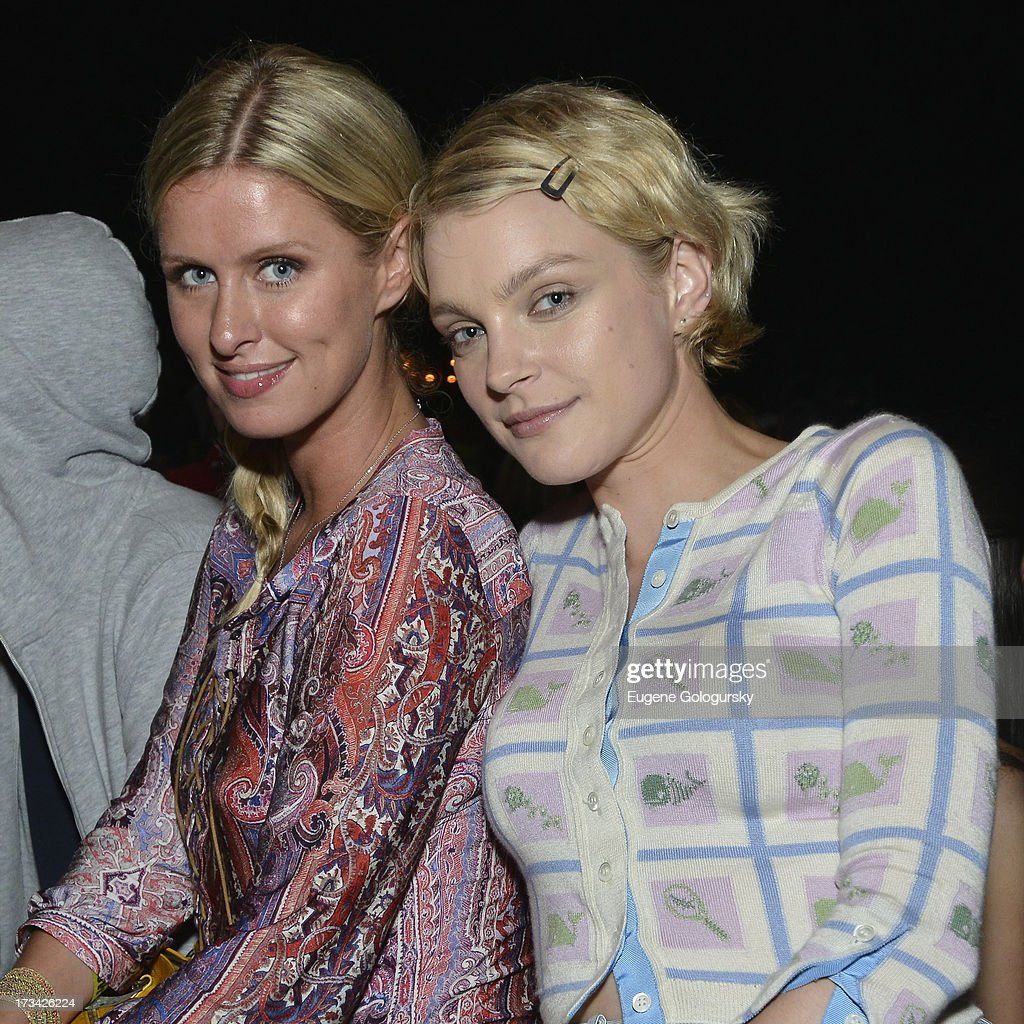 Fashion darlings, <a gi-track='captionPersonalityLinkClicked' href=/galleries/search?phrase=Jessica+Stam&family=editorial&specificpeople=657570 ng-click='$event.stopPropagation()'>Jessica Stam</a> and Nicky Hilton, cozy up to each other during Samsung's Summer DJ Series to launch the Giga Sound system at Surf Lodge on July 13, 2013 in Montauk, New York.