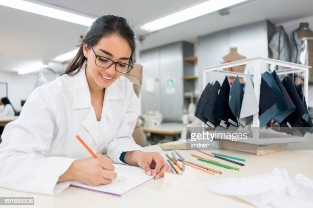 Fashion design student taking notes at the university