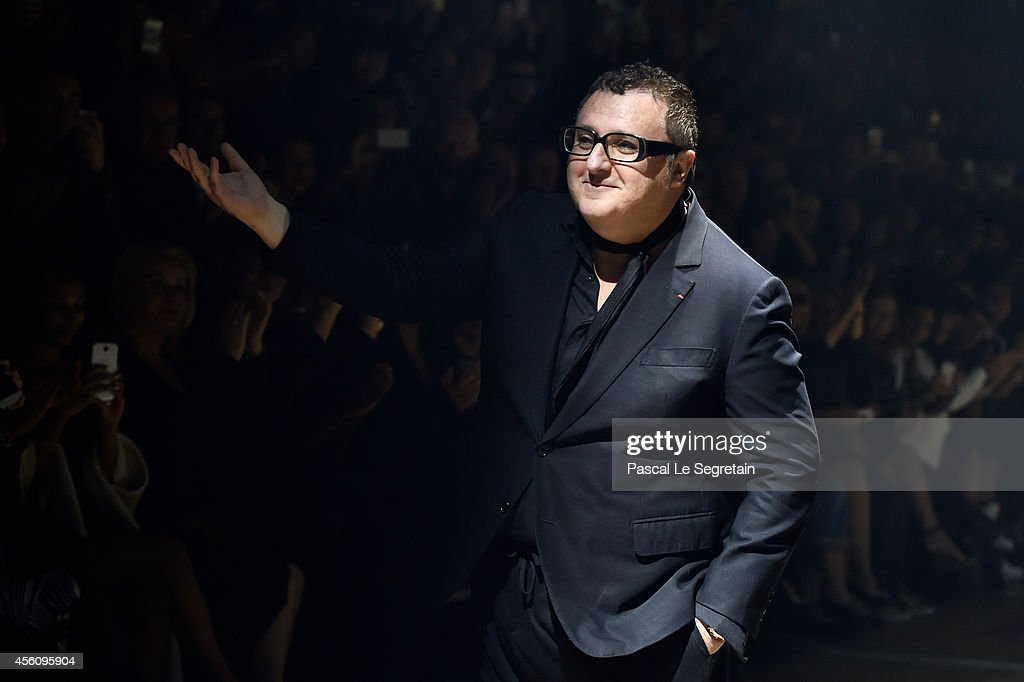Fashion designer <a gi-track='captionPersonalityLinkClicked' href=/galleries/search?phrase=Alber+Elbaz&family=editorial&specificpeople=783481 ng-click='$event.stopPropagation()'>Alber Elbaz</a> acknowledges the applause of the public after the Lanvin show as part of the Paris Fashion Week Womenswear Spring/Summer 2015 on September 25, 2014 in Paris, France.