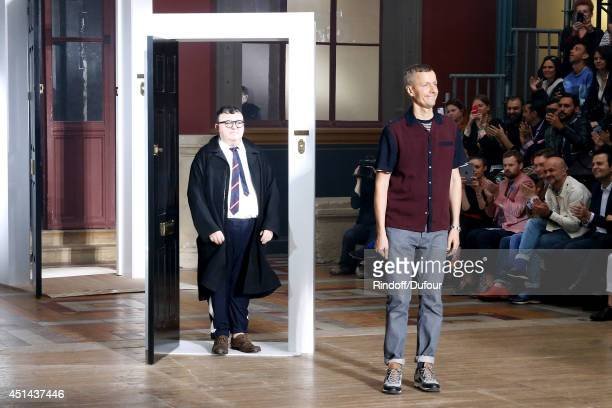 Fashion designer Alber Elbaz and Lanvin men fashion designer Lucas Ossendrijver acknowledges the applause of the audience at the end of the Lanvin...