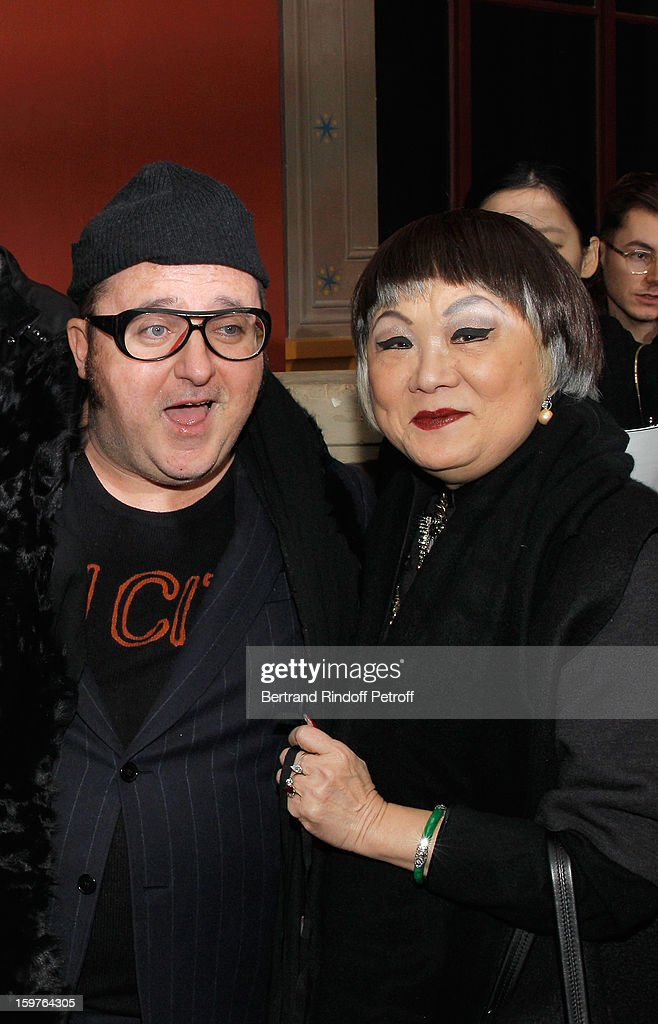 Fashion designer <a gi-track='captionPersonalityLinkClicked' href=/galleries/search?phrase=Alber+Elbaz&family=editorial&specificpeople=783481 ng-click='$event.stopPropagation()'>Alber Elbaz</a> (L) and Lanvin's owner, Shaw Lan Wang, pose following the Lanvin Men Autumn / Winter 2013 show at Ecole Nationale Superieure Des Beaux-Arts as part of Paris Fashion Week on January 20, 2013 in Paris, France.