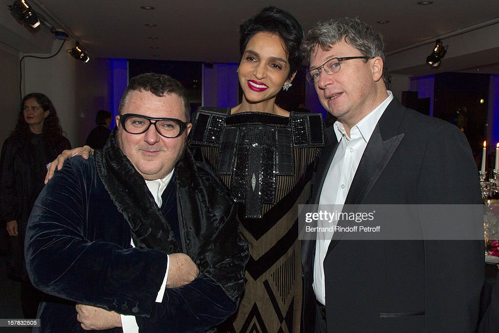 Fashion designer Alber Elbaz, Farida Khelfa Seydoux and her husband Henri Seydoux attend the annual charity dinner for the children of Rwanda, hosted by Babeth Djian to the benefit of A.E.M. (Association Children of The World), at Espace Cardin on December 6, 2012 in Paris, France.