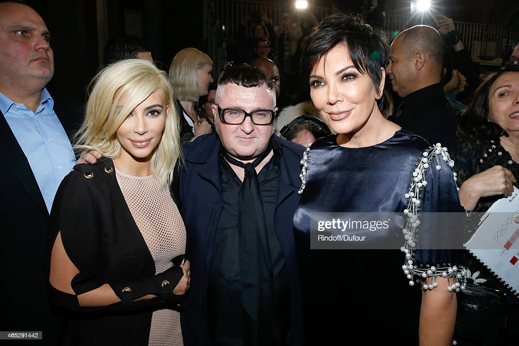 Fashion Designer Alber Elbaz pose between Kim Kardashian and her mother Kris Jenner after the Lanvin show as part of the Paris Fashion Week Womenswear Fall/Winter 2015/2016. Held at Ecole des Beaux Arts on March 5, 2015 in Paris, France.