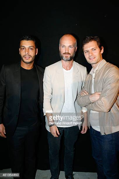 Fashion Designer Aldo Maria Camillo poses between actors Hugo Becker and Adele Bencherif after the Cerruti show as part of the Paris Fashion Week...