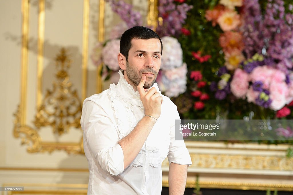 Fashion designer Alexis Mabille acknowledges applause following the Alexis Mabille show as part of Paris Fashion Week Haute-Couture Fall/Winter 2013-2014 at Hotel dEvreux on July 1, 2013 in Paris, France.
