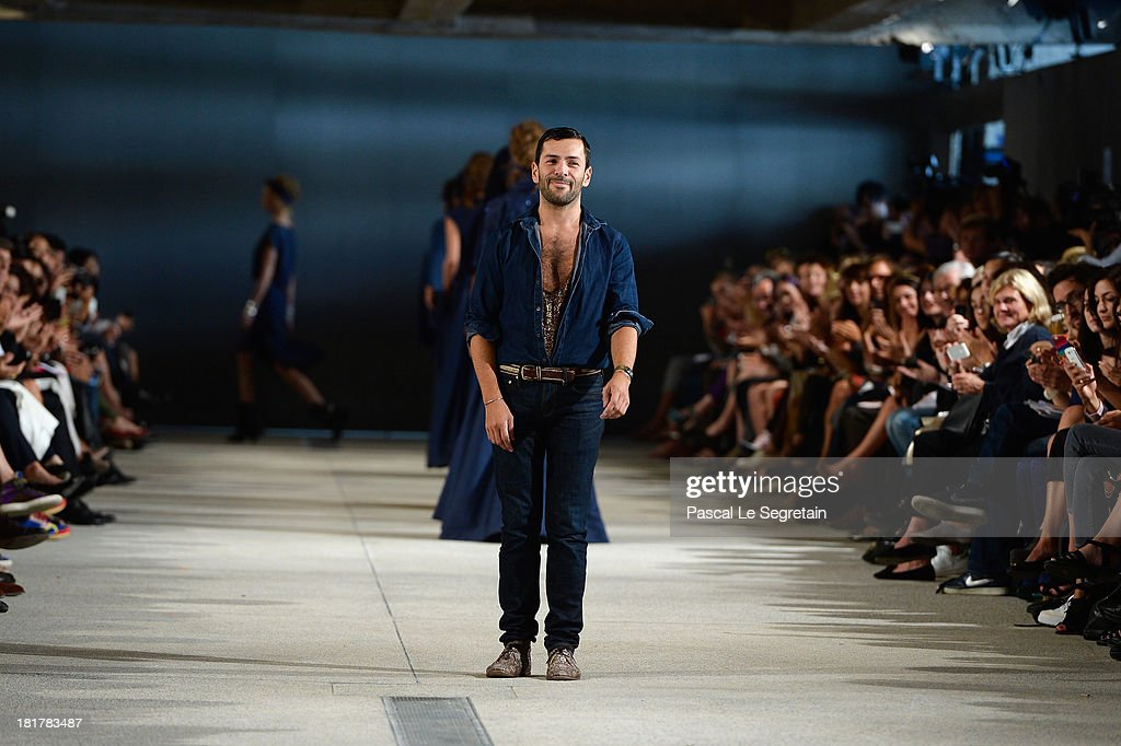 Fashion designer Alexis Mabille acknowledges applause following the Alexis Mabille show as part of the Paris Fashion Week Womenswear Spring/Summer 2014 at Docks en Seine on September 25, 2013 in Paris, France.