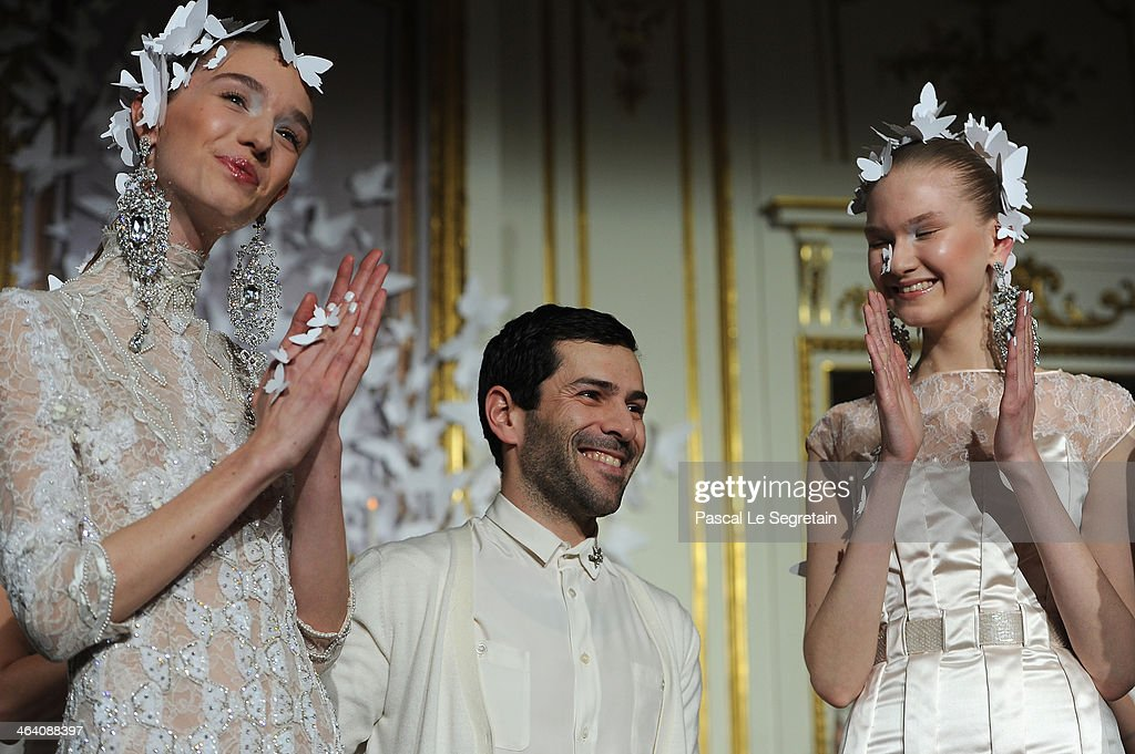 Fashion designer <a gi-track='captionPersonalityLinkClicked' href=/galleries/search?phrase=Alexis+Mabille+-+Fashion+Designer&family=editorial&specificpeople=4851254 ng-click='$event.stopPropagation()'>Alexis Mabille</a> (C) acknowledges the applause of the audience after the <a gi-track='captionPersonalityLinkClicked' href=/galleries/search?phrase=Alexis+Mabille+-+Fashion+Designer&family=editorial&specificpeople=4851254 ng-click='$event.stopPropagation()'>Alexis Mabille</a> show as part of Paris Fashion Week Haute Couture Spring/Summer 2014 on January 20, 2014 in Paris, France.