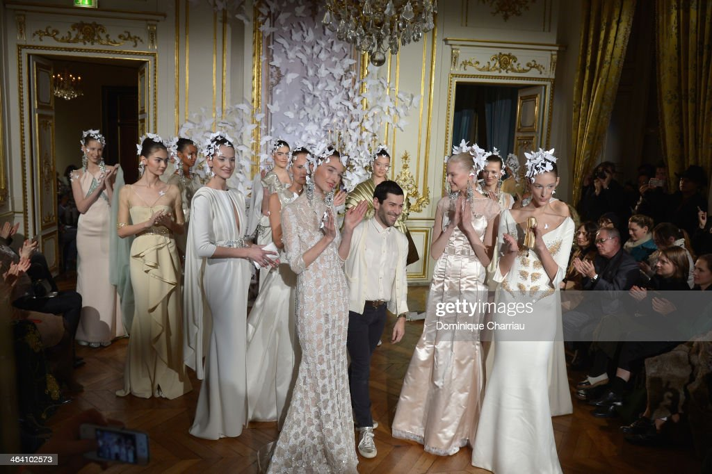Fashion designer Alexis Mabille (C) acknowledges the applause of the audience after the Alexis Mabille show as part of Paris Fashion Week Haute Couture Spring/Summer 2014 on January 20, 2014 in Paris, France.