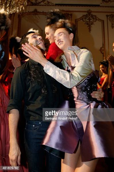 Fashion designer Alexis Mabille and a model attend the Alexis Mabille show as part of Paris Fashion Week Haute Couture Fall/Winter 20142015 on July 7...