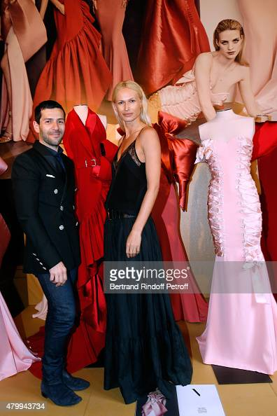 Fashion Designer Alexis Mabille and Model Inga Savits attend the Presentation of the Alexis Mabille Haute Couture Fall/Winter 2015/2016 collection as...