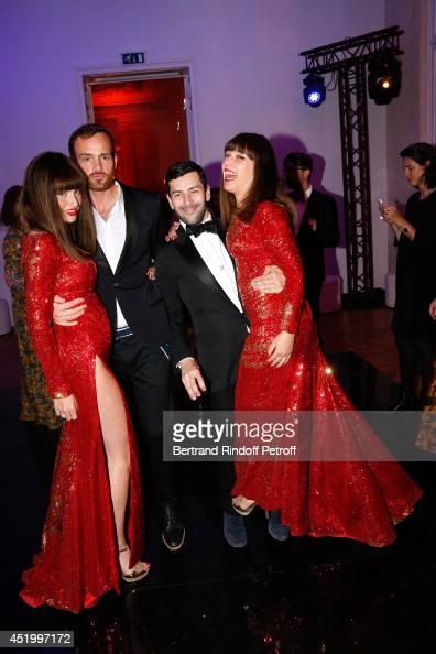 Fashion designer Alexis Mabille dancing between les Brigittes Sylvie Hoarau and Aurelie Saada attend the 'Chambre Syndicale de la Haute Couture'...