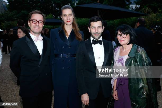 Fashion designer Alexis Mabille his brother Martin Mabille with his wife Myrthe Mabille and their mother Mireille Mabille attend the 'Chambre...