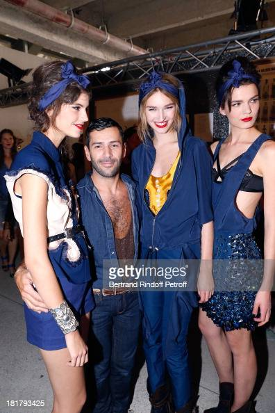 Fashion Designer Alexis Mabille with his models backstage after his show as part of the Paris Fashion Week Womenswear Spring/Summer 2014 at Docks en...