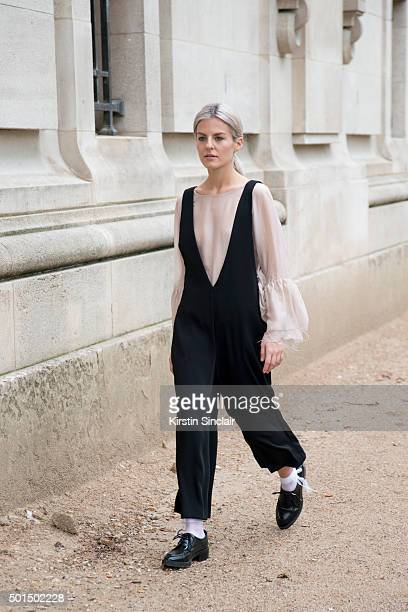 Fashion Designer and Blogger Maria Ilic wears Zara shoes H and M shirt and Zara dungarees on day 8 during Paris Fashion Week Spring/Summer 2016/17 on...