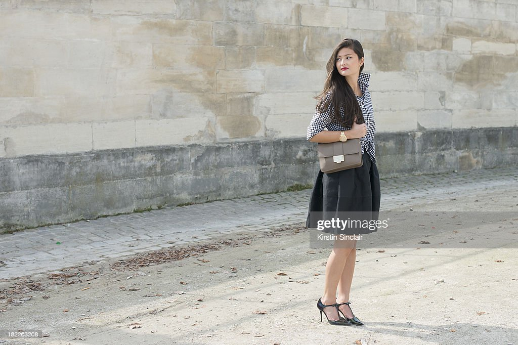 Fashion Designer and blogger Peony Lim wears Thomas Pink shirt, Golden Goose skirt and Jimmy Choo bag and shoes on day 5 of Paris Fashion Week Spring/Summer 2014, Paris September 28, 2013 in Paris, France.