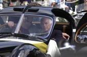 Fashion designer and car aficionado Ralph Lauren right sits in his 1938 Bugatti Type 57SC Atlantic vintage automobile winner best of show in 1990 at...