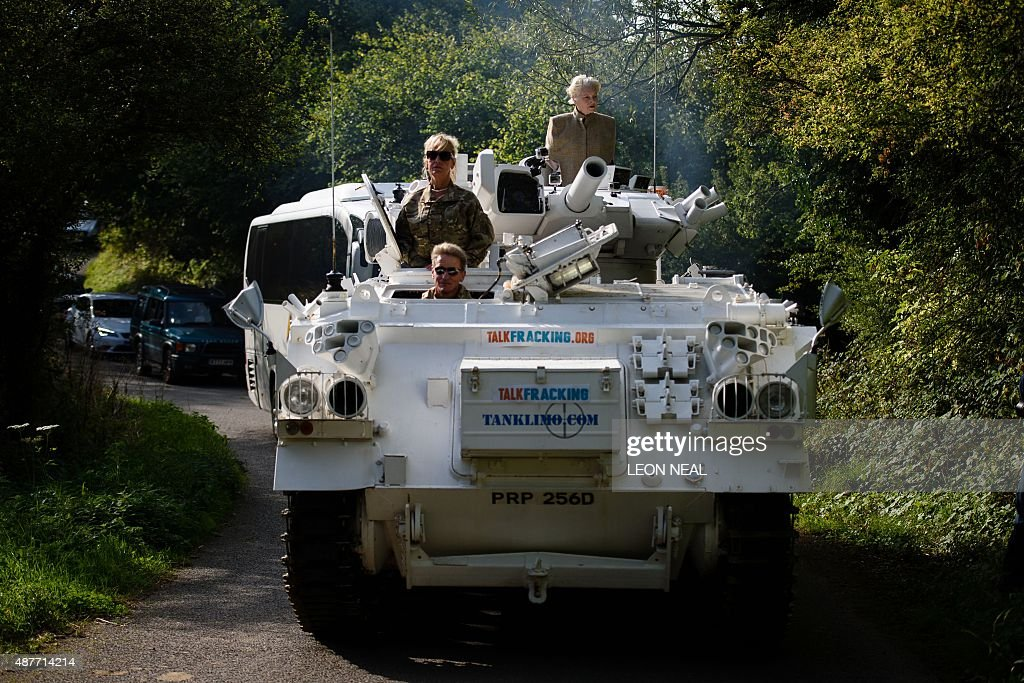 Fashion designer and environmental campaigner Vivienne Westwood rides on top of an armored personnel carrier towards the home of British Prime...
