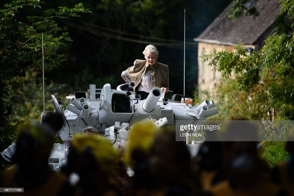 Fashion designer and environmental campaigner Vivienne Westwood rides on top of an armored personnel carrier outside the home of British Prime...